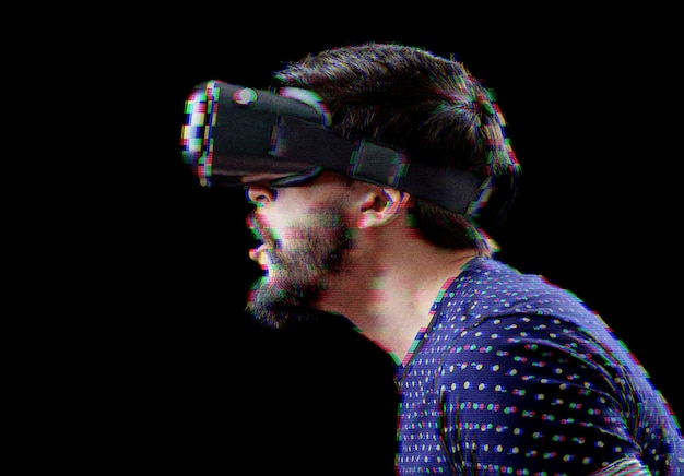 Man with vr goggles over digital glitch effects