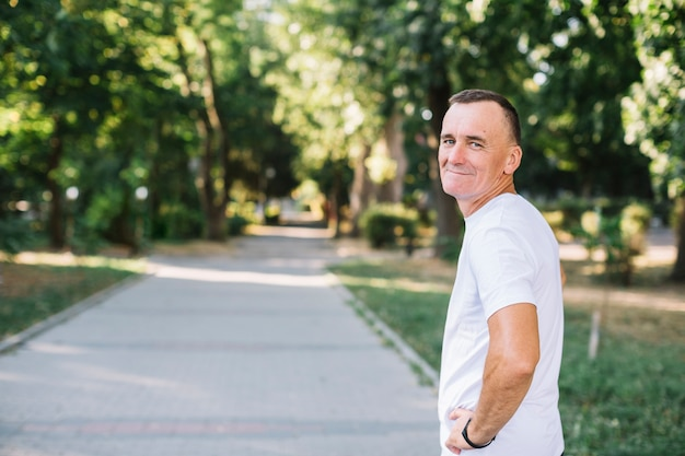 Man with white t-shirt looking to camera