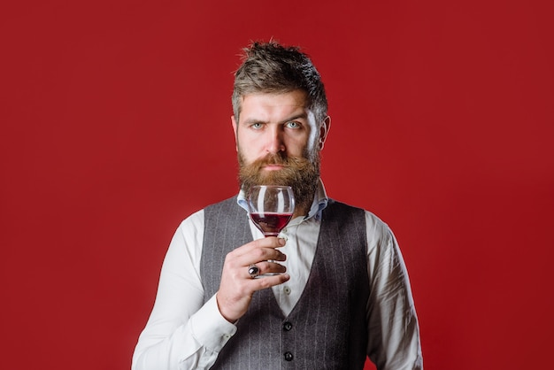 Man with wine glass bearded man with glass of wine tasting alcohol red wine man drinks wine man with