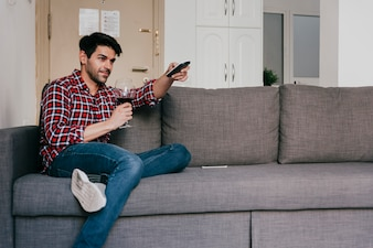 Man with wine on couch