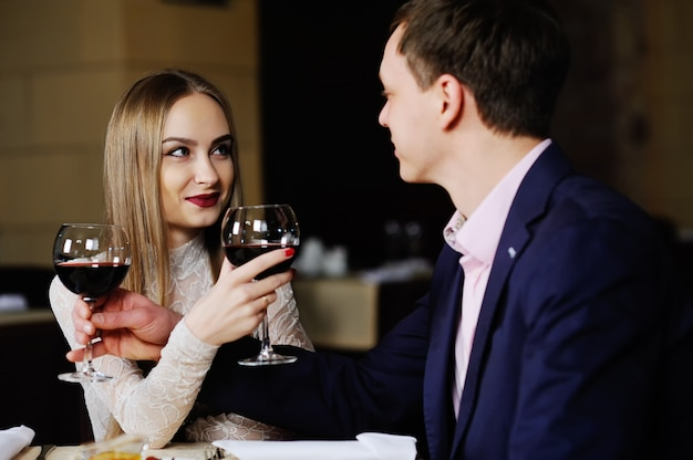 A man with a woman having dinner at a restaurant.