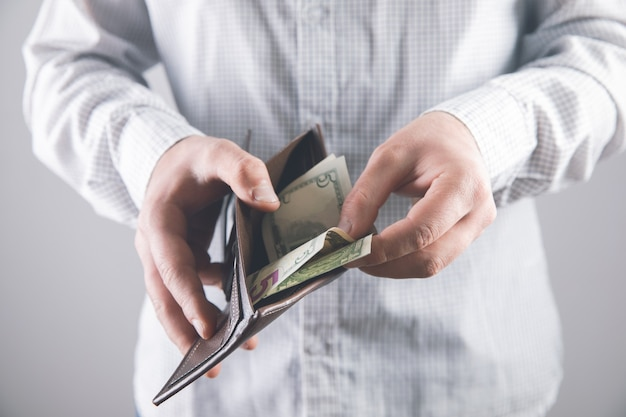 Man withdraws money from wallet .