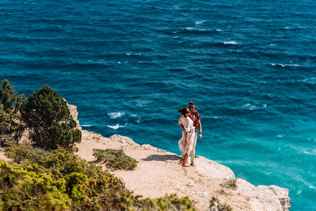 Man and woman on the beach. couple on their honeymoon. couple travels the world. happy couple on vacation. holidays on beautiful islands. tourists on vacation. trip to the islands. copy space