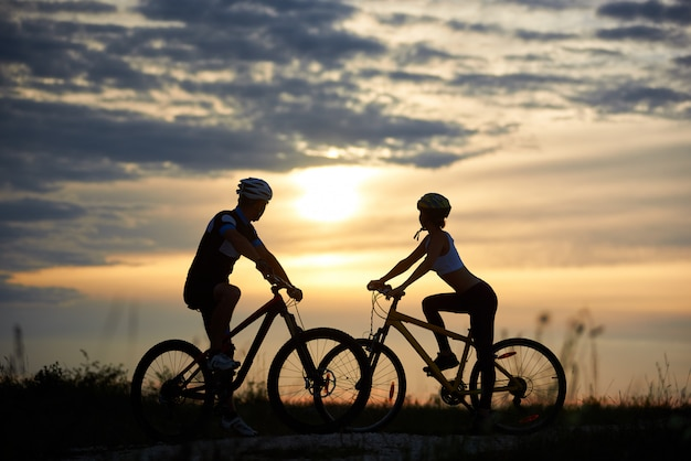 Man and woman on bicycles