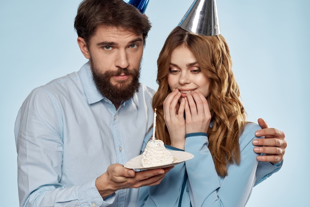 A man and a woman on a birthday with a cupcake and a candle