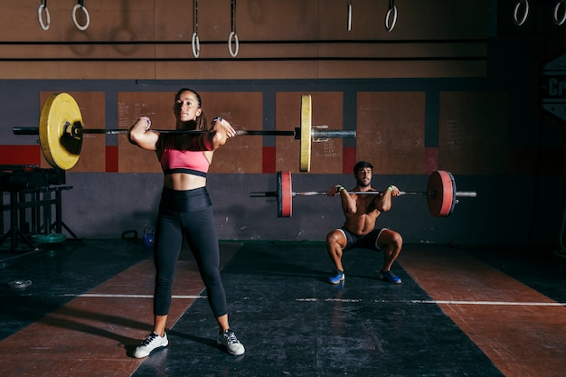 Man and woman bodybuilding