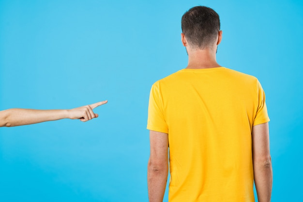 A man and a woman in bright color t-shirts posing together, a couple