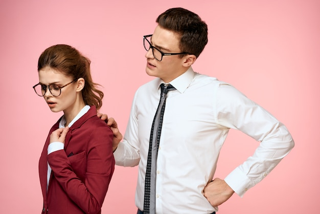 Man and woman in business suits posing, color space.