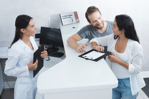 A man and a woman came to see a dentist