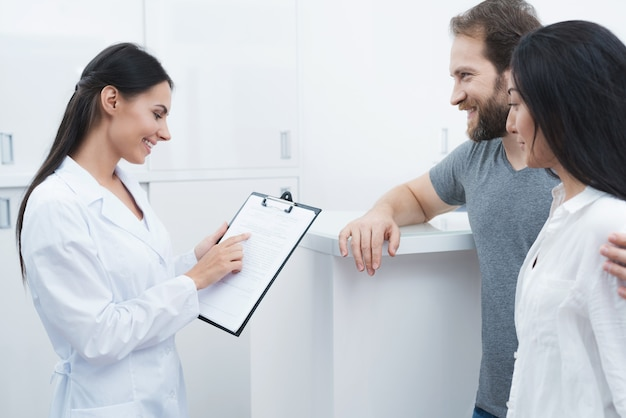 A man and a woman came to see a dentist.