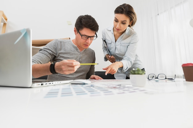 Man and woman carefully working on  business papers