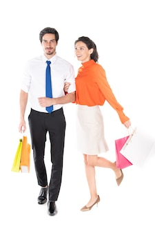 Man and woman carrying bags