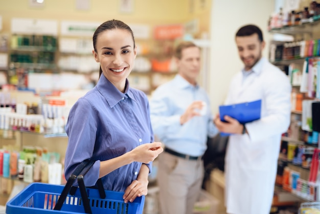 Man and woman choosing medicines in pharmacies.