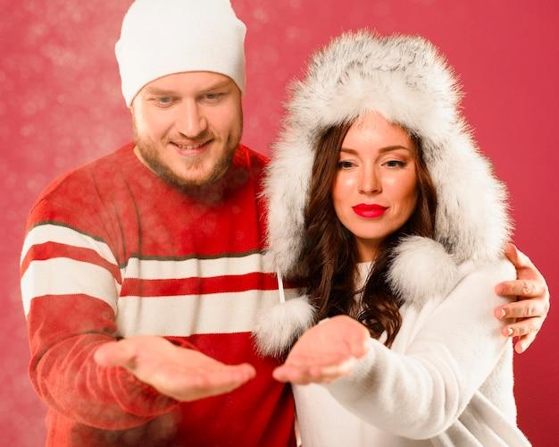 Man and woman christmas models looking at hands