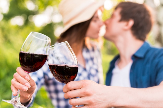 Man and woman clinking glasses with wine