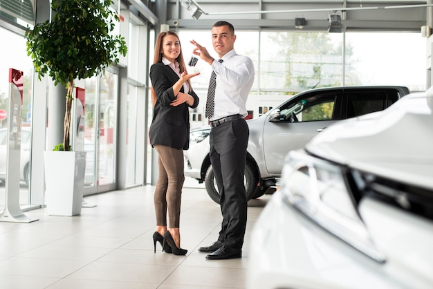 Man and woman closing a car deal