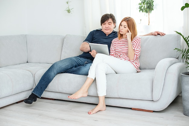 Man and woman communicate by video link