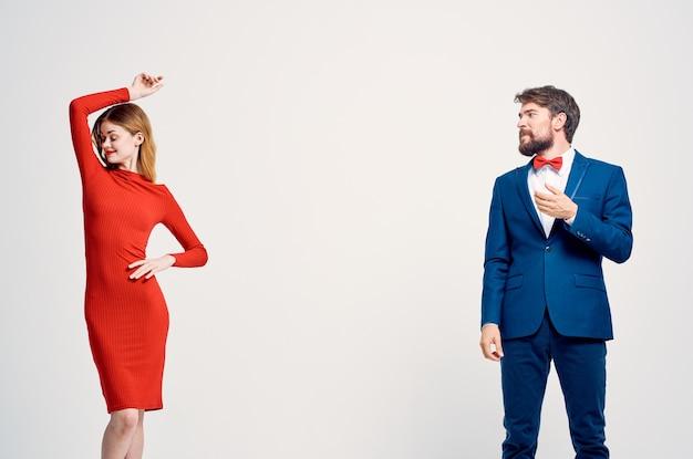 Man and woman communication fashion light background. high quality photo