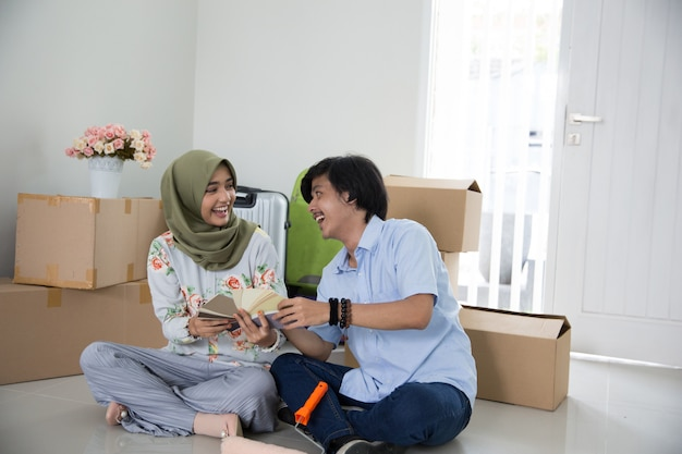 Man and woman couple sitting at their new house