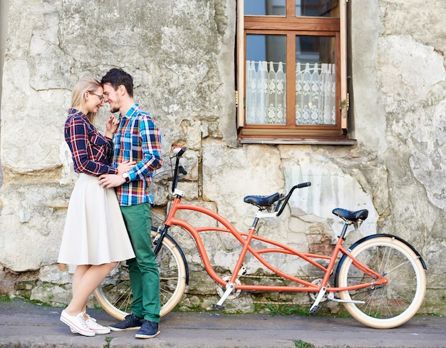 Man and woman cycling together tandem double bike
