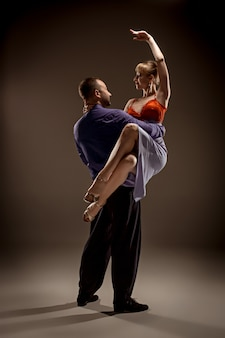 Man and woman dancing argentinian tango