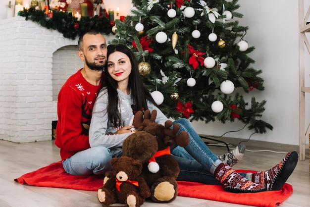 Man and woman embracing near soft toys