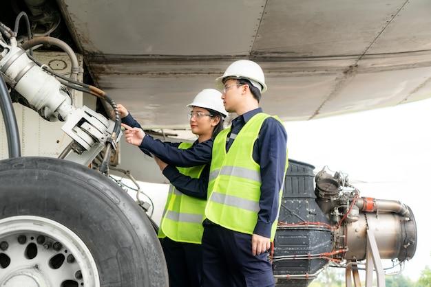Man and woman engineer maintenance airplane