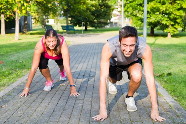 Man and woman exercising at the park