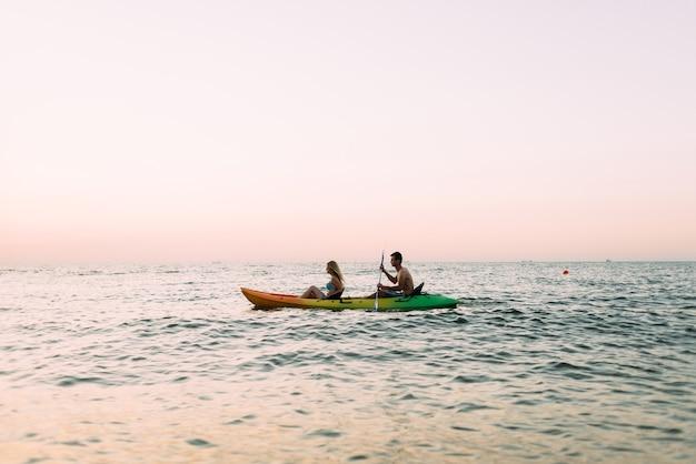 Man and woman exploring ocean in a kayak