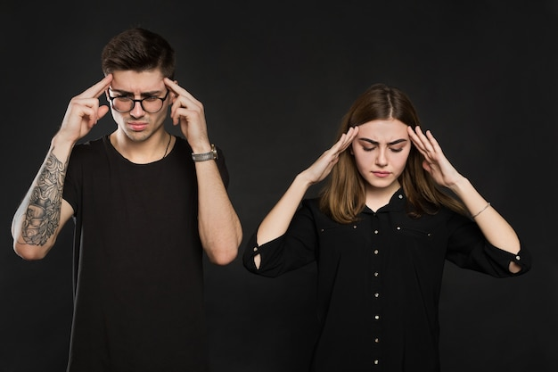 Man and woman feeling stressed and angry at each other