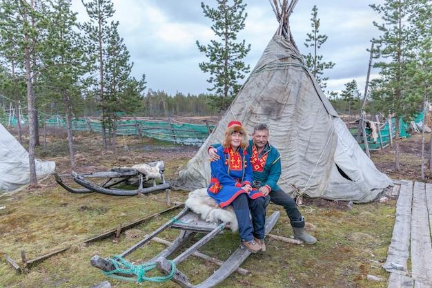 Man and woman, female saami, sami in national dress, saami village on the kola peninsula, russia. Premium Photo