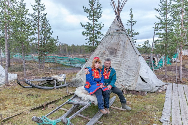 Man and woman, female saami, sami in national dress, saami village on the kola peninsula, russia.