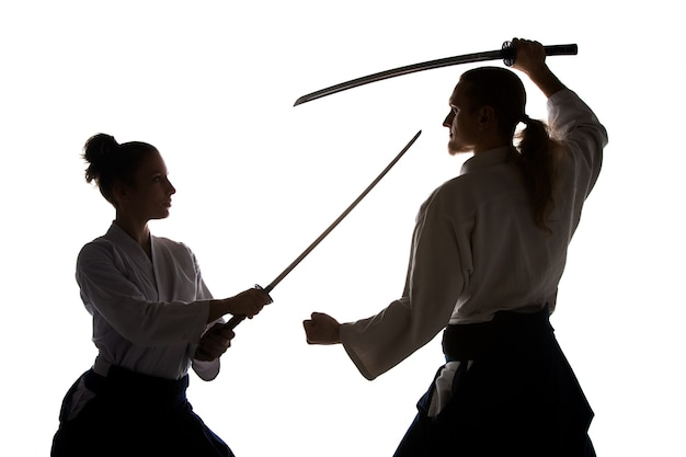 Man and woman fighting at aikido training in martial arts school healthy lifestyle and sports