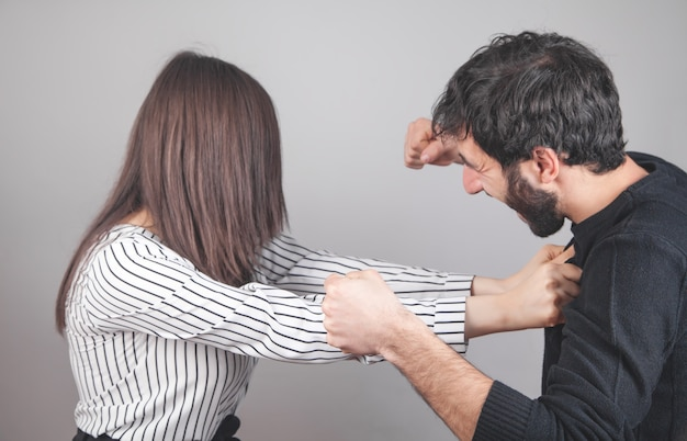 Man and woman fighting at home.