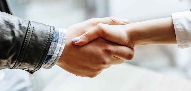 Man and woman hand shaking. handshake after good cooperation, businesswoman shaking hands with professional businessman after discussing good deal of contract. business concept.