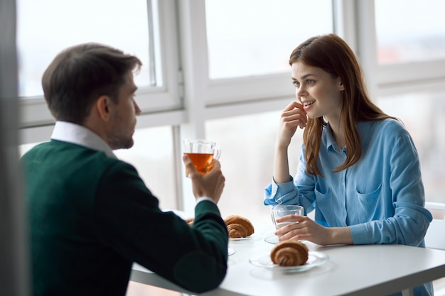 Man and woman have breakfast together, business breakfast, couple breakfast