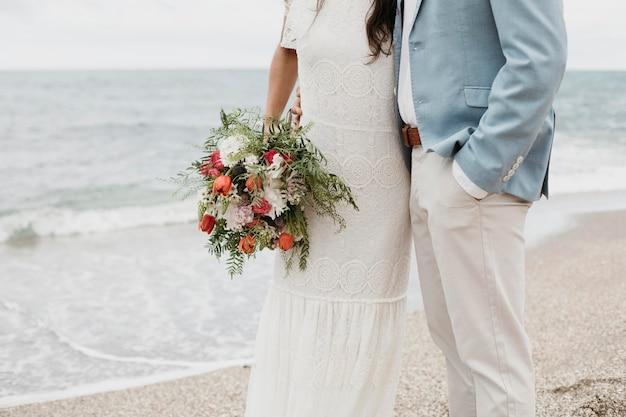 Man and woman having a beach wedding
