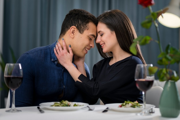 Man and woman having a romantic valentine's day dinner at home