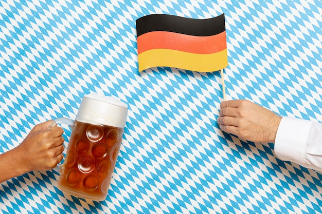Man and woman holding beer pint and flag