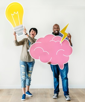 Man and woman holding bulb and pink cloud icons respectively