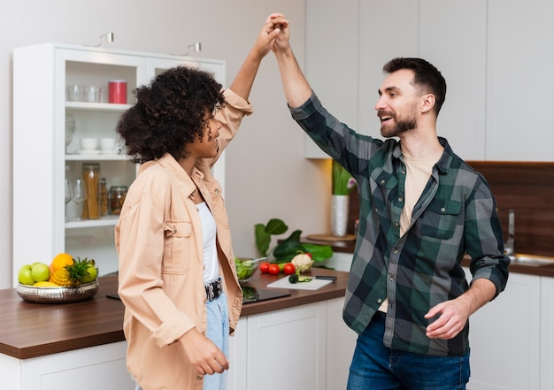 Man and woman holding hands in kitchen