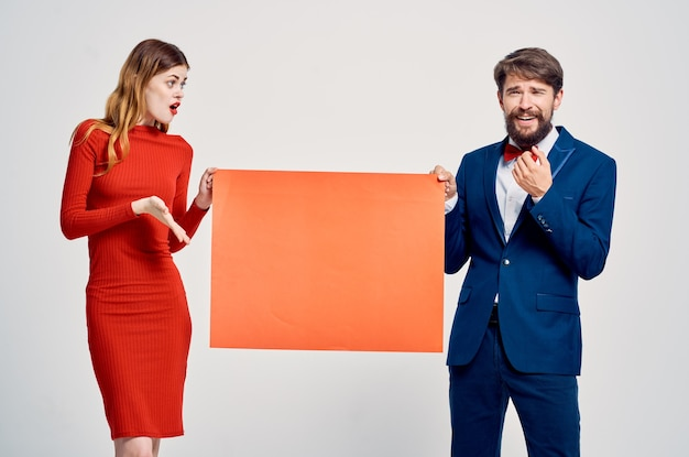 Man and woman holding mockup emotions copy space