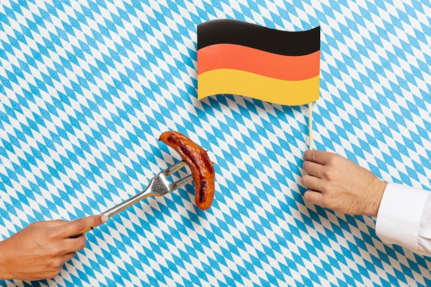 Man and woman holding sausage and flag