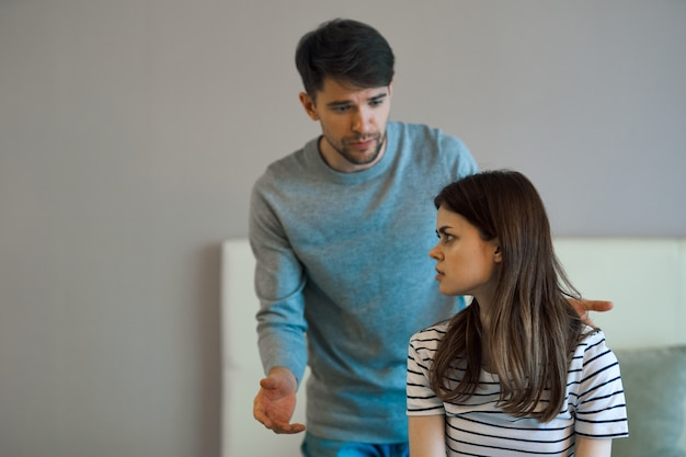 Man and woman at home in the bedroom communication conflict quarrel