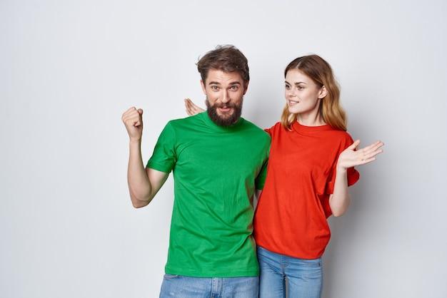 Man and woman hug friendship colorful tshirts family studio lifestyle