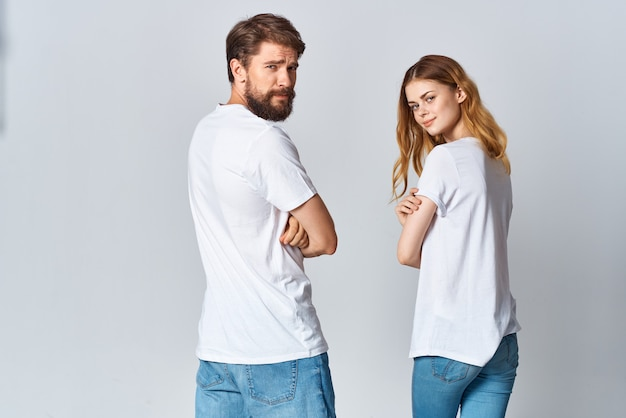 Man and woman hugging in white tshirts mockup back view
