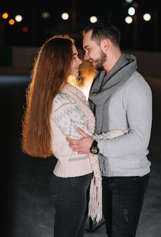 Man and woman on an ice skating rink