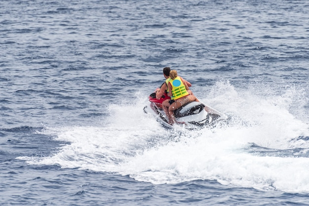 Man and a woman on a jet sky