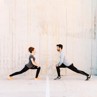 Man and woman lunging together
