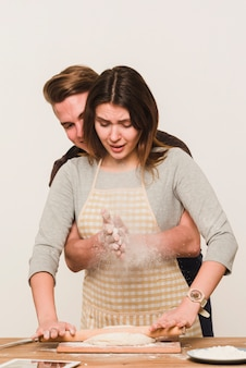 Man and woman making dough